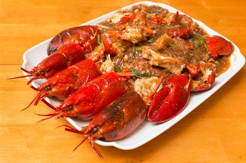 Chinese Ginger Scallion Lobster. Chinese Cantonese Style stir fried Lobsters with ginger, green onion and cellophane noodles stock photography