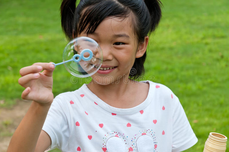 Download Chinese girl blow bubbles stock photo. Image of happy - 27438404