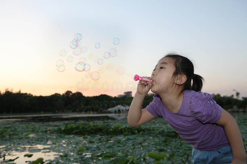 Download Chinese Girl Blowing Bubbles Stock Photo - Image: 20671252