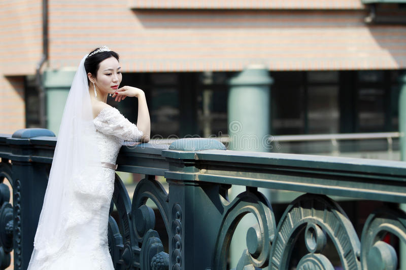 Chinese Girl Bride In Wedding Dress With A Beautiful Imperial Crown ...