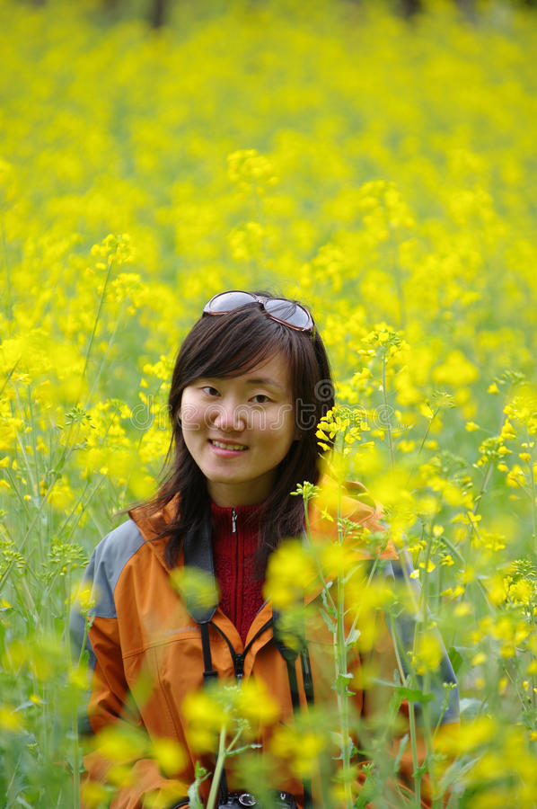 Chinese Girl In Cole Flowers Stock Photos