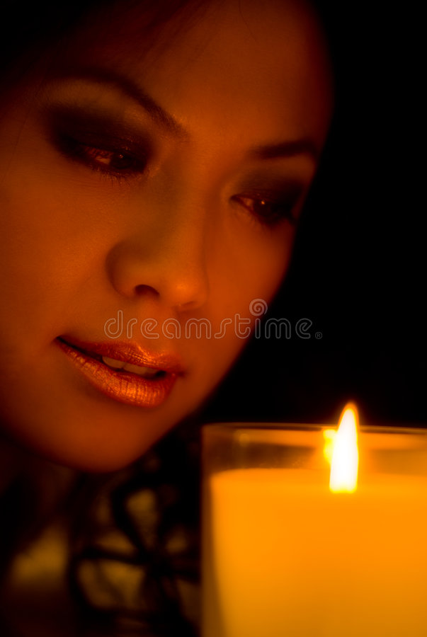 Download Chinese Girl Looking At A Candle Stock Image - Image: 7511673