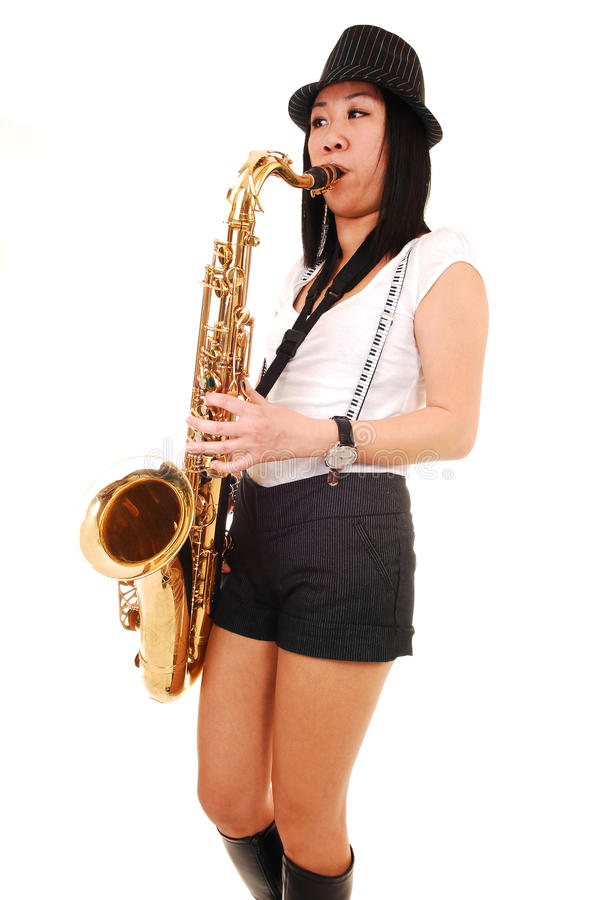 Free Chinese Girl Playing The Saxophone. Royalty Free Stock Photo - 14041715