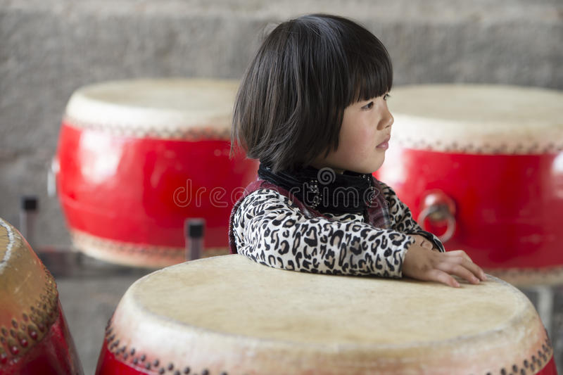 Chinese girl plays big drums stock images