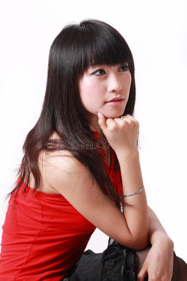 Chinese girl in pondering royalty free stock photos