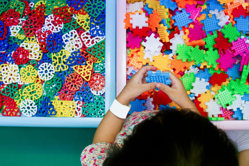 Chinese girl solving puzzle royalty free stock photo