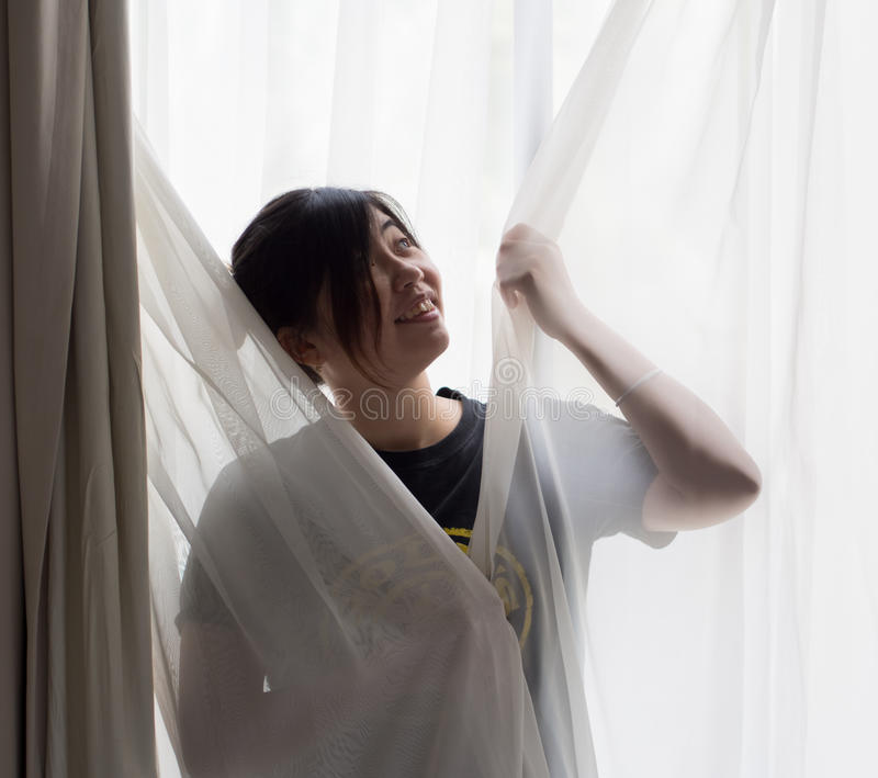Chinese Girl Standing in Front of Window royalty free stock image