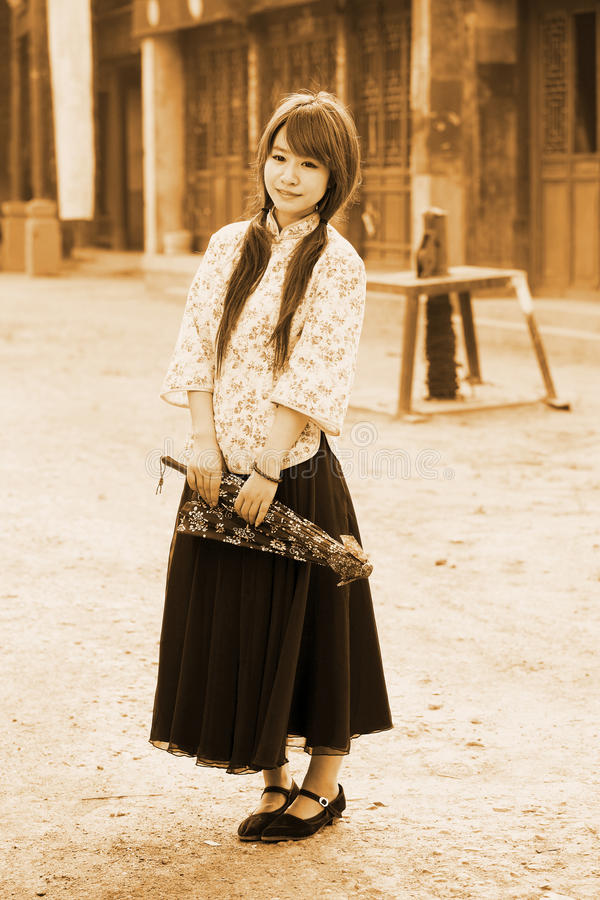 Download Chinese Girl In Traditional Dress Stock Image - Image of student, standing: 19973447