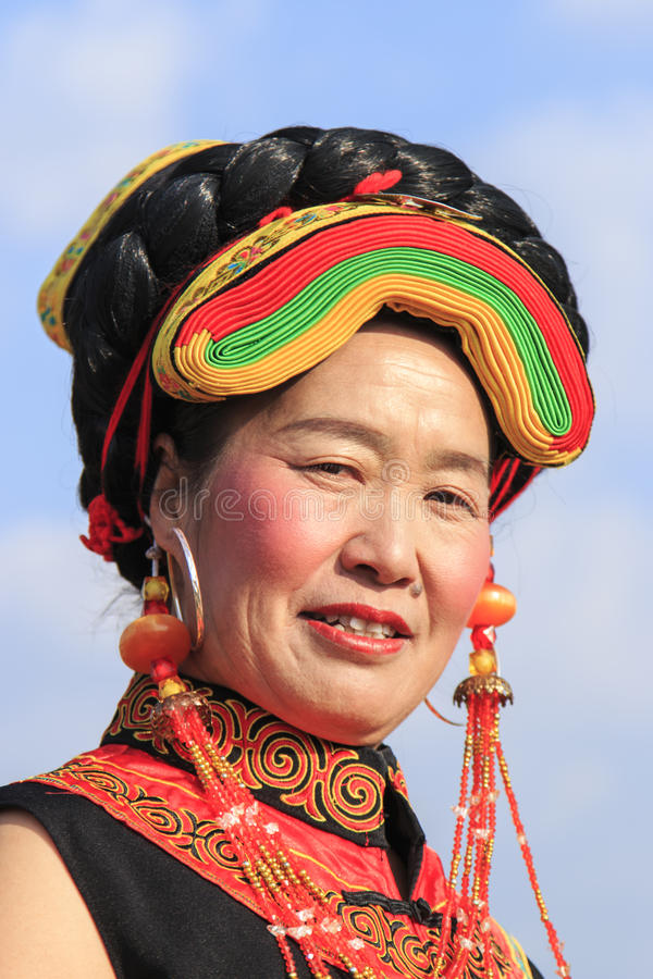 Chinese girl in traditional Miao clothing during the Heqing Qifeng Pear Flower festival. Heqing, China - March 15, 2016: Chinese girl in traditional Miao royalty free stock image
