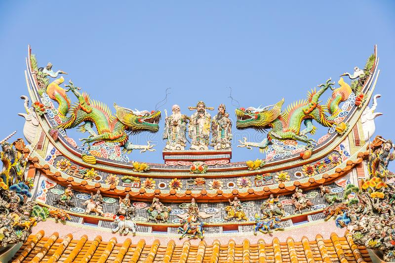 Chinese god sculpture on roof top of chinese temple and some space for write wording, special unique design in chinese style royalty free stock photo
