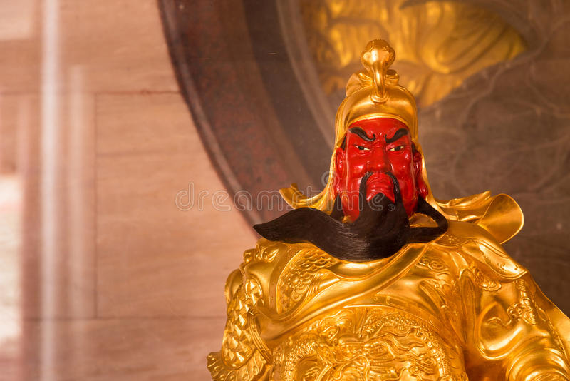 The Chinese golden goddess statue at Wat Borom Raja Kanjanapisek Wat Leng Nei Yee 2 Temple, People go to temple to pray for good royalty free stock images