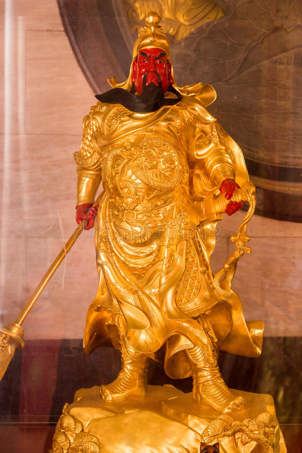 The Chinese golden goddess statue at Wat Borom Raja Kanjanapisek Wat Leng Nei Yee 2 Temple, People go to temple to pray for good royalty free stock photography