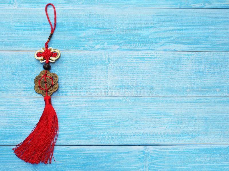 Chinese good luck symbol on wooden blue background. royalty free stock photo