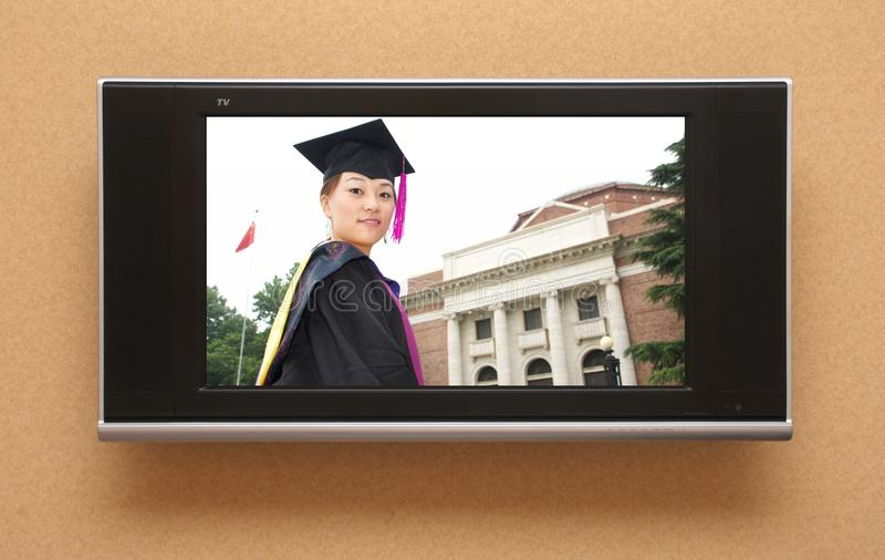 Download Chinese graduation on TV stock photo. Image of woman - 12536410