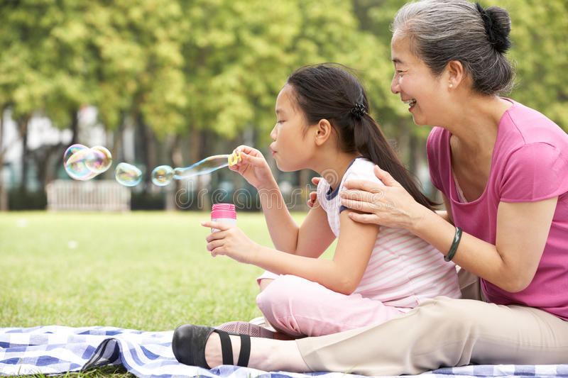 Download Chinese Grandmother With Granddaughter In Park Stock Photos - Image: 26097843