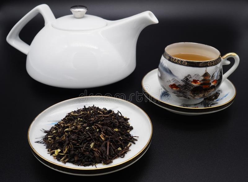 Chinese green tea and porcelain cups royalty free stock photos