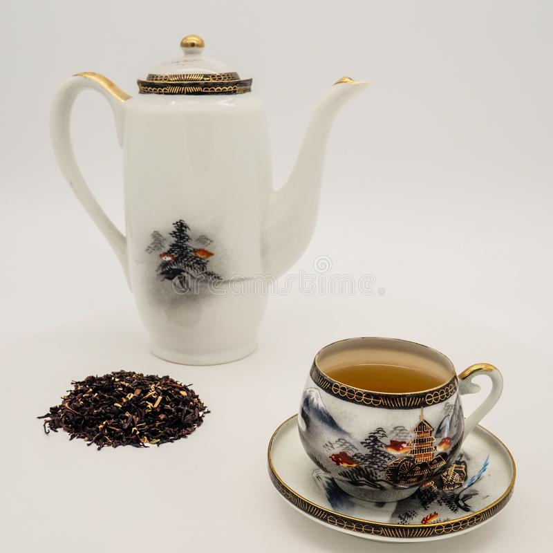 Chinese green tea and porcelain cups stock image