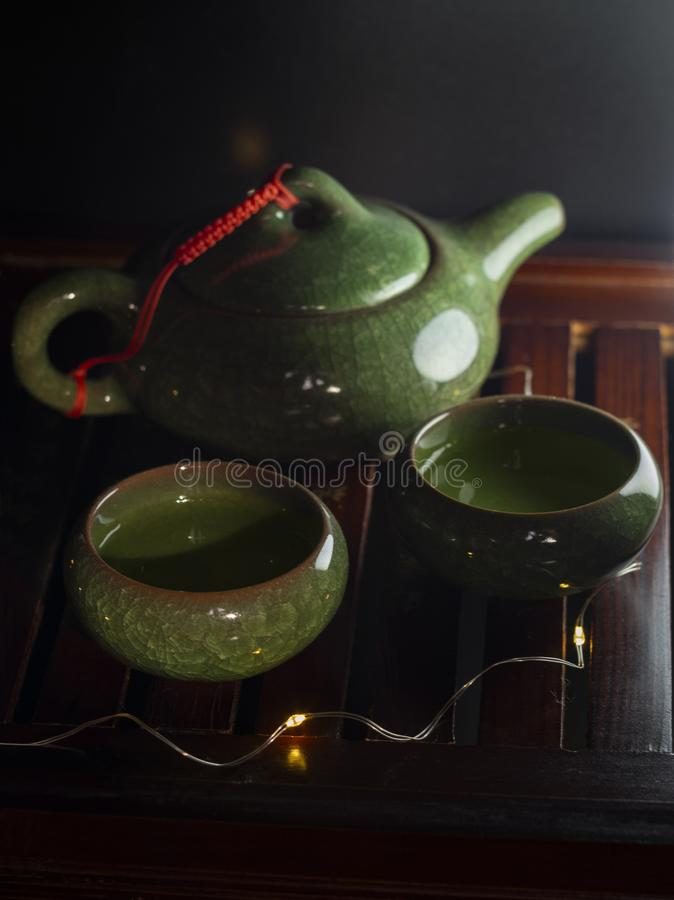 Chinese green tea set with tea on a special stand at the tea ceremony stock photography