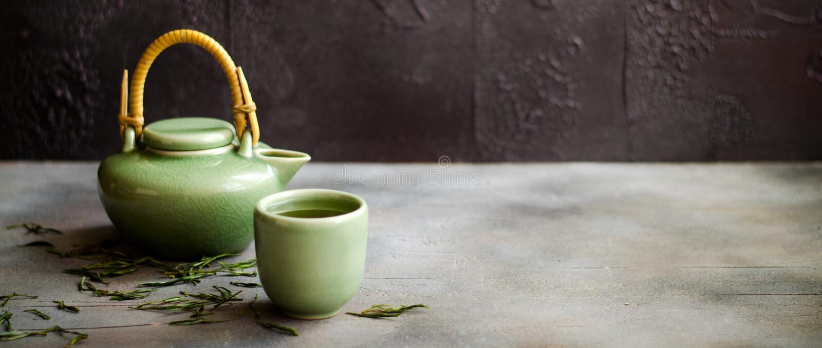 Chinese green tea in teapot on dark background royalty free stock photos