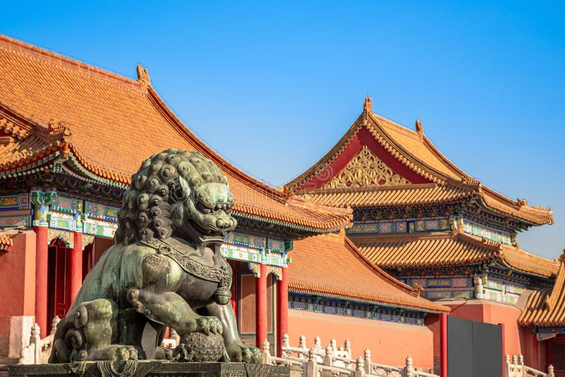 Chinese guardian lion or shishi statue from Ming dynasty era, at the entrance to the palace in the Forbidden City, Beijing, China royalty free stock photos