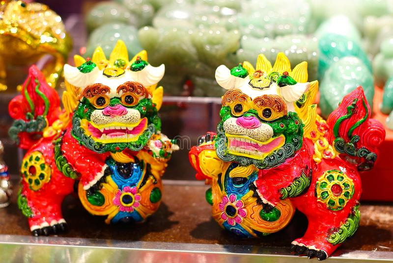 Chinese guardian lions. Hong Kong - October 6,2018: Chinese paired guardian lions known as lion dogs, foo dogs, shishi. Colorful amulet for home. Chinese style stock photos
