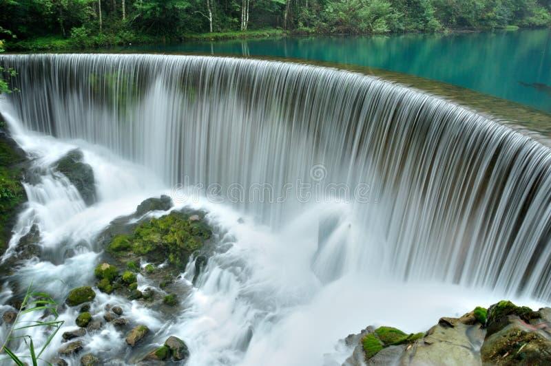 Crouching dragon pool waterfall royalty free stock photos