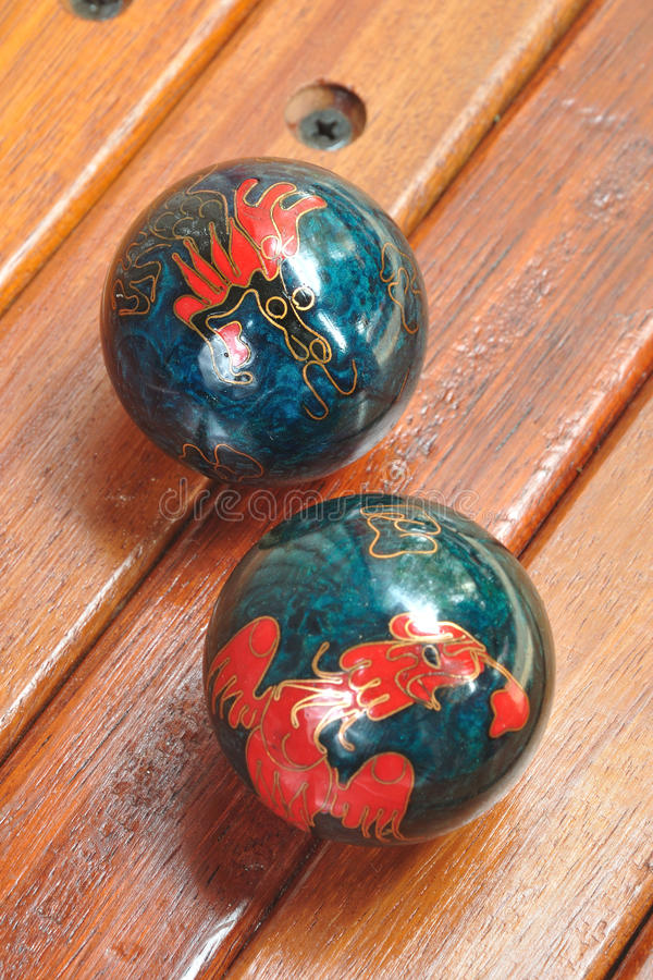 Chinese hand massage balls. In dragon decoration royalty free stock photos