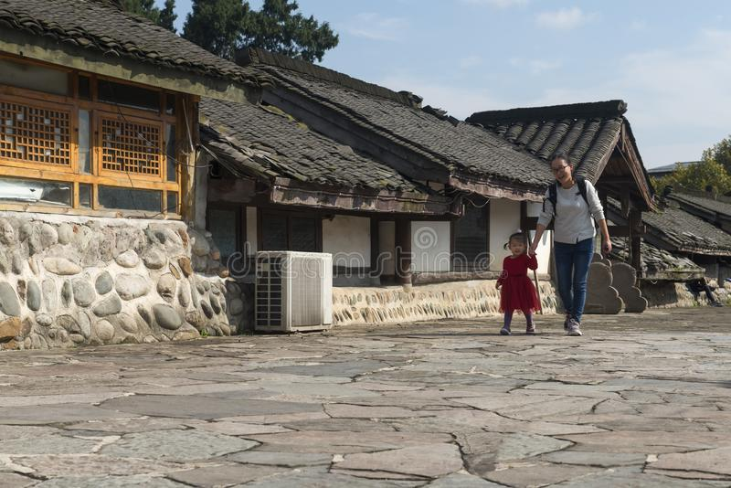 Chinese happy mom and daughter walking at dujiangyan stock images