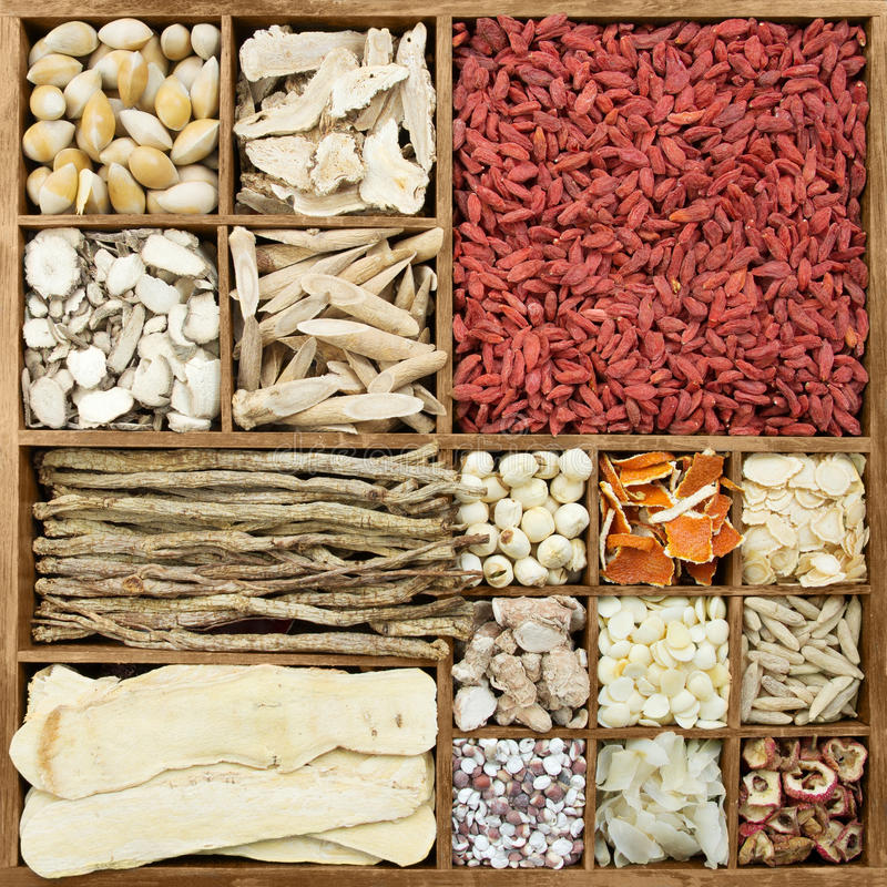 Chinese herb medicines. In a rustic wooden box royalty free stock photo