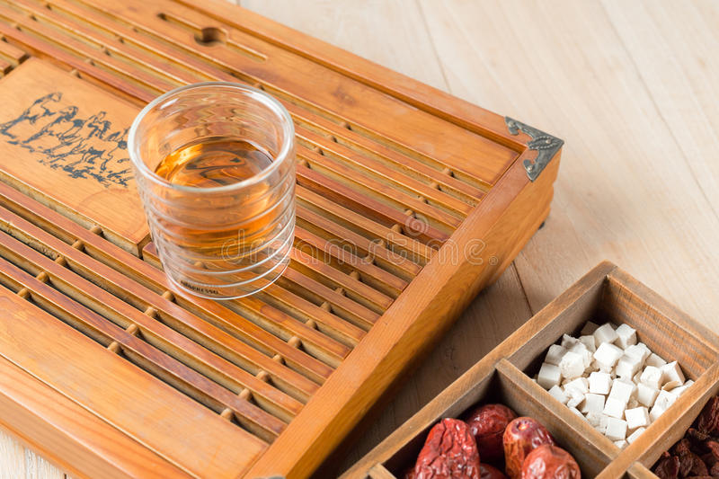 Chinese Herbal Medicine with a cup of tea on table.  royalty free stock photos