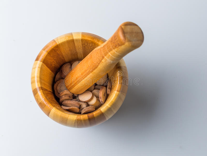 Chinese Herbal Medicine in a pestle on the table.  royalty free stock photo