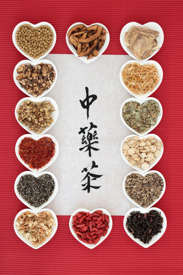 Chinese Herbal Teas. Chinese herbal tea selection in heart shaped bowls with calligraphy on rice paper. Translation reads as chinese herb tea. Used also in stock photos