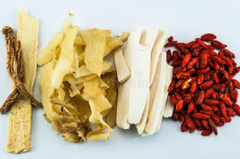 Chinese herbs on white background royalty free stock photos