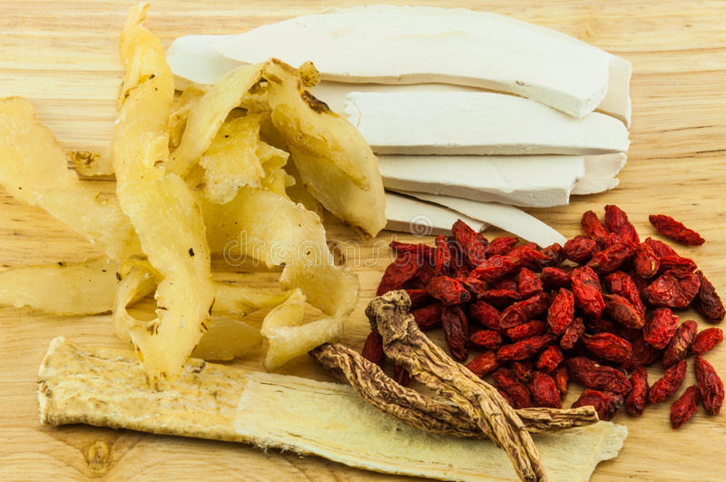 Chinese herbs on wood background royalty free stock photography