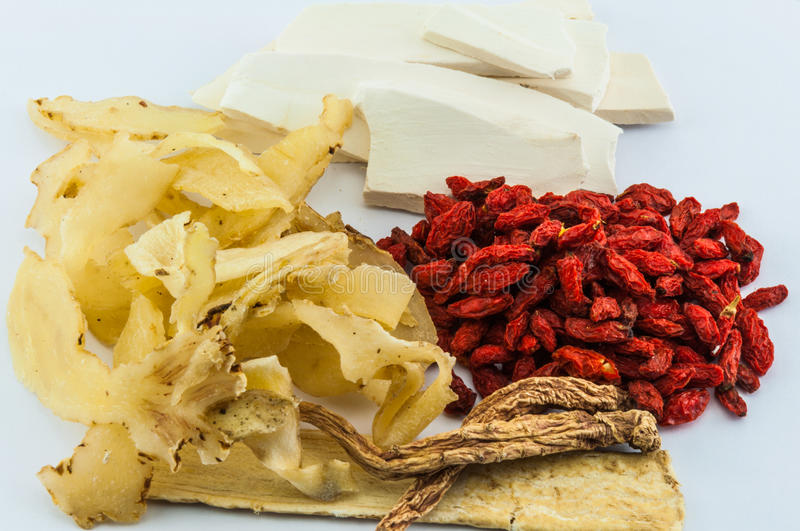 Chinese herbs on wood background royalty free stock image