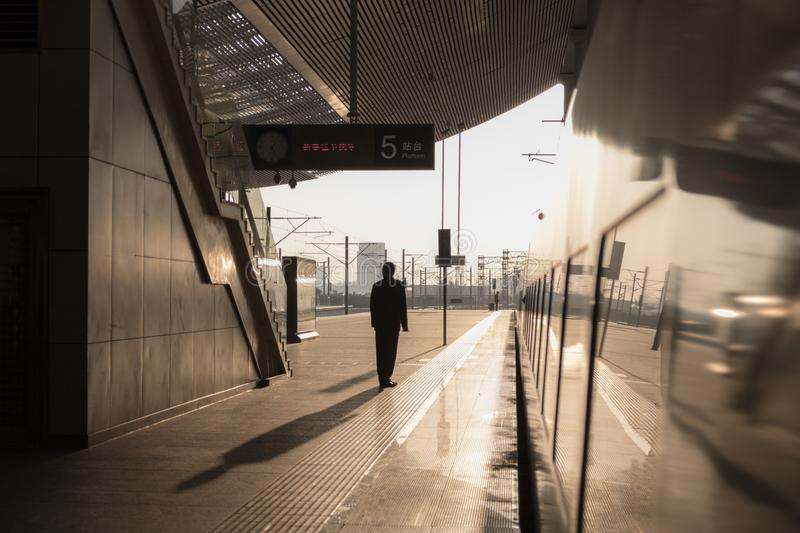 Chinese high speed train in the station. Sunset landscape. royalty free stock image