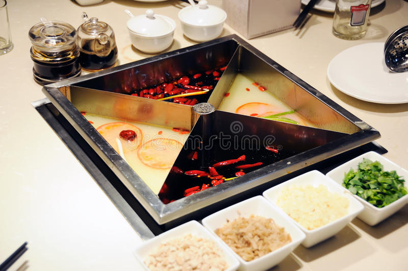 Chinese hot pot. On the table stock photos