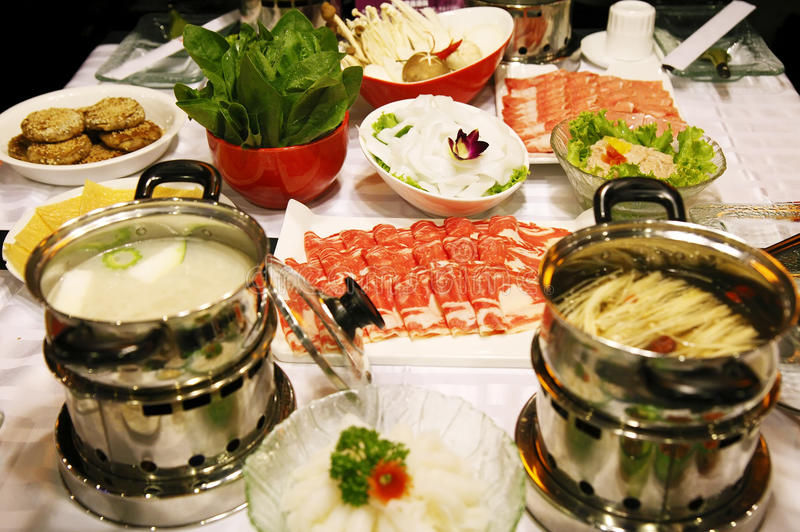 Chinese hot pot feast. Sumptuous Chinese hot pot feast on the table royalty free stock photos