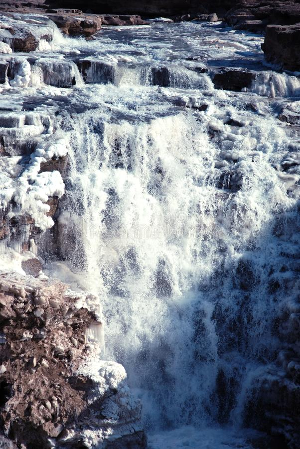 Chinese Hukou Waterfall freezing in winter. Hukou Waterfall on the Yellow River is the only yellow Great Falls, is China's second largest waterfall, known as stock image