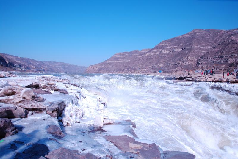 Chinese Hukou Waterfall freezing in winter. Hukou Waterfall on the Yellow River is the only yellow Great Falls, is China's second largest waterfall, known as royalty free stock photo