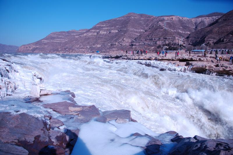 Chinese Hukou Waterfall freezing in winter. Hukou Waterfall on the Yellow River is the only yellow Great Falls, is China's second largest waterfall, known as royalty free stock photography