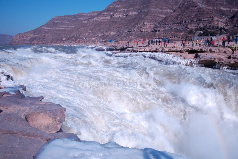 Chinese Hukou Waterfall freezing in winter. Hukou Waterfall on the Yellow River is the only yellow Great Falls, is China's second largest waterfall, known as royalty free stock image