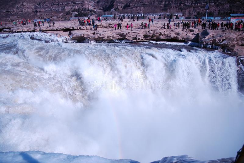 Chinese Hukou Waterfall freezing in winter. Hukou Waterfall on the Yellow River is the only yellow Great Falls, is China's second largest waterfall, known as stock photography