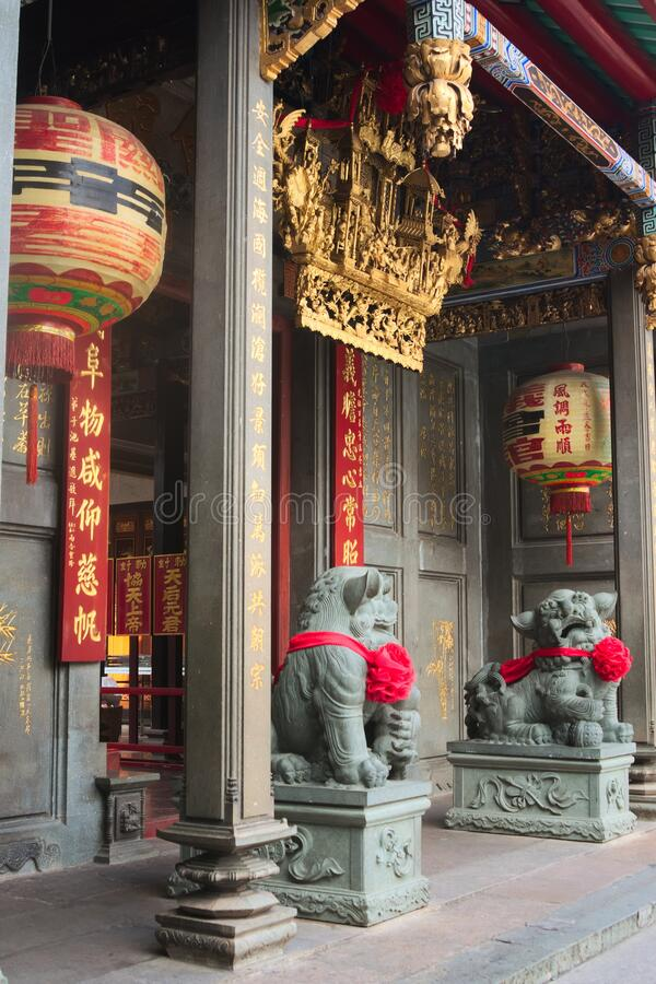 Chinese Imperial guardian lions, made of stone, guarding the gate at a buddhist temple in Saigon, Vietnam Ho Chi Minh City.  stock photography