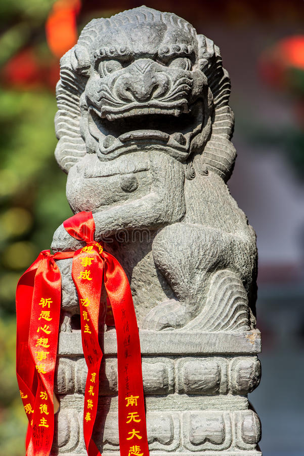 chinese imperial lion statue in the The Jade Buddha Temple shanghai china stock photo