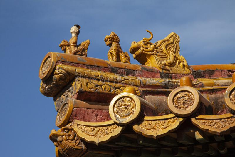 Chinese imperial roof decoration or roof charms, or roof figures with emperor and creatures in the Forbidden City in Beijing, Chin stock images
