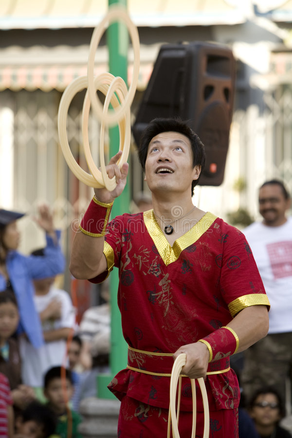 Chinese Juggler 4. LOS ANGELES CHINATOWN, CA - SEPT 14: Chinese juggler Haitao, performs in the 2008 Moon Festival in Los Angeles' Chinatown royalty free stock photos