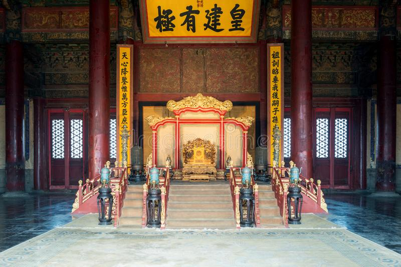 Chinese king`s throne in Hall of Central Harmony at Beijing Forbidden City in Beijing, China stock photo