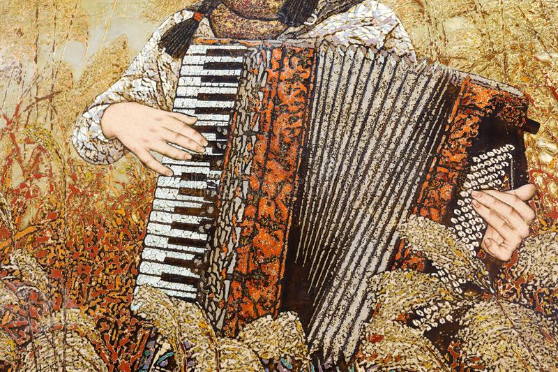 The lacquer painting of female accordion player in reeds, adobe rgb royalty free stock images