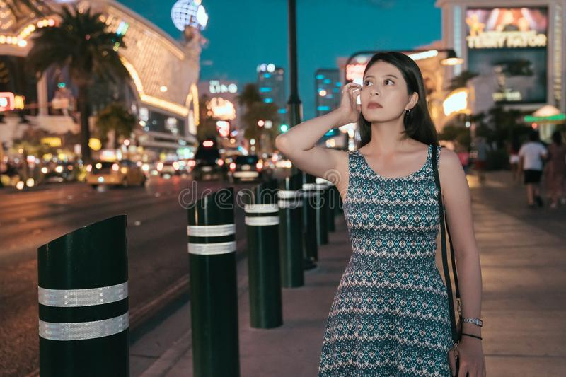 Chinese lady with dress walking flicks hair stock images